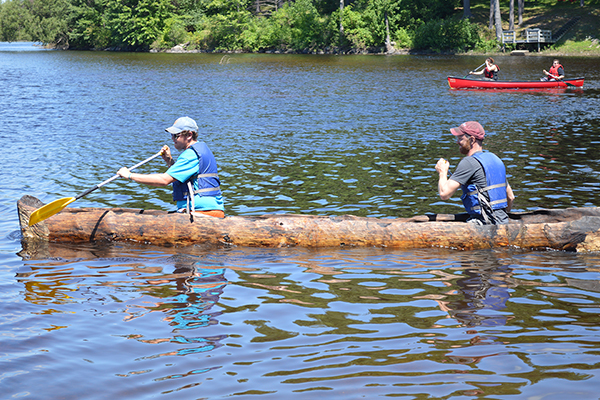 Students riding in a dugout canoe