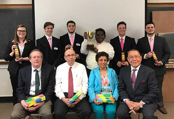 Following this year's business plan and product prototype competition at SUNY Potsdam, the judging panel posed for a photo with the winners