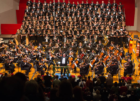 Photo of Dean Michael Sitton conducting, along with the Crane Chorus and Crane Symphony Orchestra