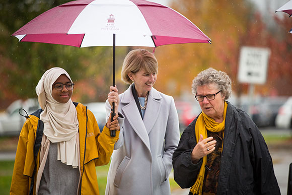 Photo of Chancellor Dr. Kristina M. Johnson, SGA President Kadiatou Balde and Faculty Senate Chair Kimberley Bouchard
