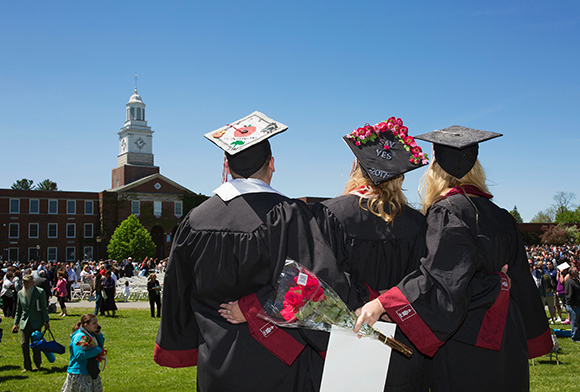 Photo from left, Joshua Overrocker '17, Anneliese Bishop '17 and Jacqueline Herb '17 look out over the Academic Quad before last year's Commencement at SUNY Potsdam.