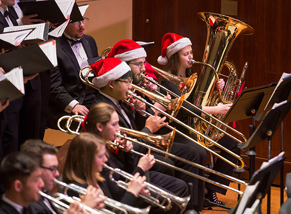 Students in Crane Symphony Orchestra's brass section during 2018 Crane Candlelight Concert.