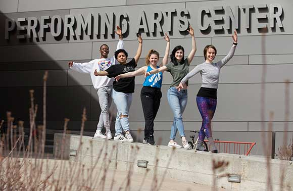 Photo of SUNY Potsdam dance students Stephon Williams, Alonicha Triana, Laura Kelly, Emma Starace and Creszenz Bergmeier outside the Performing Arts Center