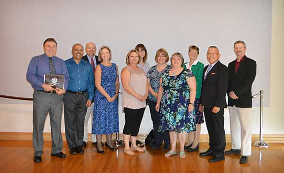 Photo of Toby White, Rajendra Chakranarayan, Eric Duchscherer, Nancy Griffin, Claudette Fefee, Karen Wilson, Lisa Murphy, Kathryn Pierce, Kristin Esterberg, Edwin Portugal and Joe Timmerman.