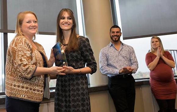 photo of student receiving Community Champion Award