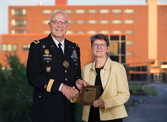 Photo of President Esterberg with Brig. Gen. Dr. Leon L. Robert Jr.