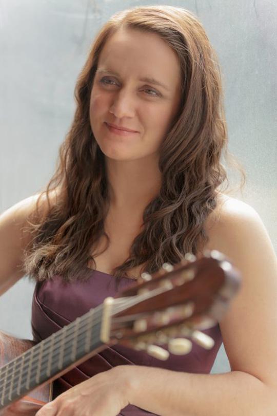 Image of Guitarist Lynn McGrath that will be presenting in alumni recital.