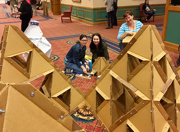 photo of students participating in construction of tetrahedron