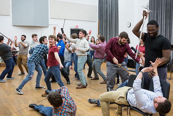 "Crane Opera Ensemble students rehearse a fight scene for ""The Pirates of Penzance."""