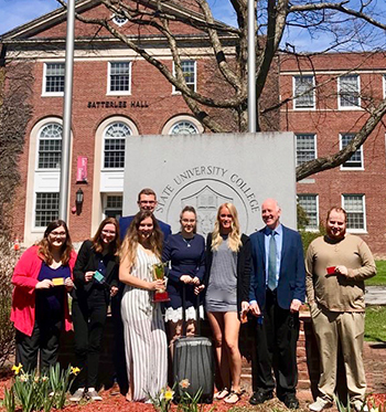 Members of the winning team in this semester's Business Plan and Prototype Competition at SUNY Potsdam posed outside Satterlee Hall following their winning presentation.