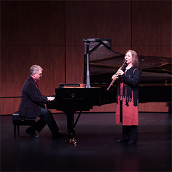 Julianne Kirk Doyle and Michael Sitton performing
