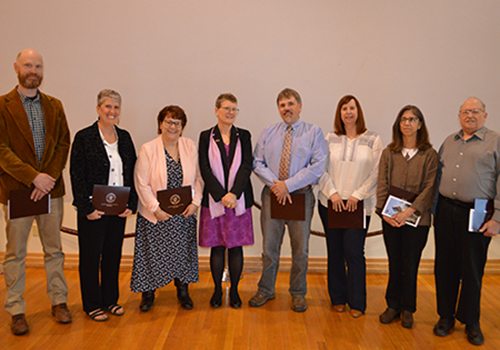 The 2019 President's Award recipients posed with President Kristin Esterberg after receiving their honors. From left, Timothy Messner, Tracy Harcourt, Karen Miller, Kristin Esterberg, Roy Smith, Kristin Jordan, M.J. Heisey and John Bard (not pictured: Marcy Lottie and Mark Campbell).